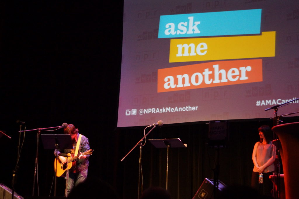 Jonathan Coulton playing guitar during Ask Me Another live.