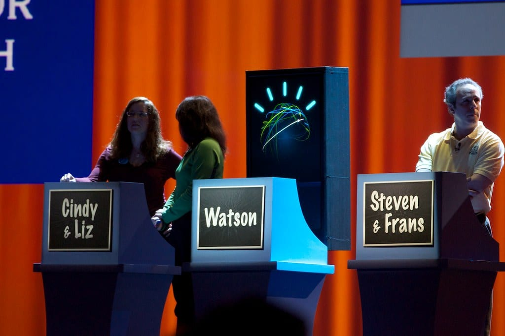 Jeopardy! players and podiums, including A.I. Watson.