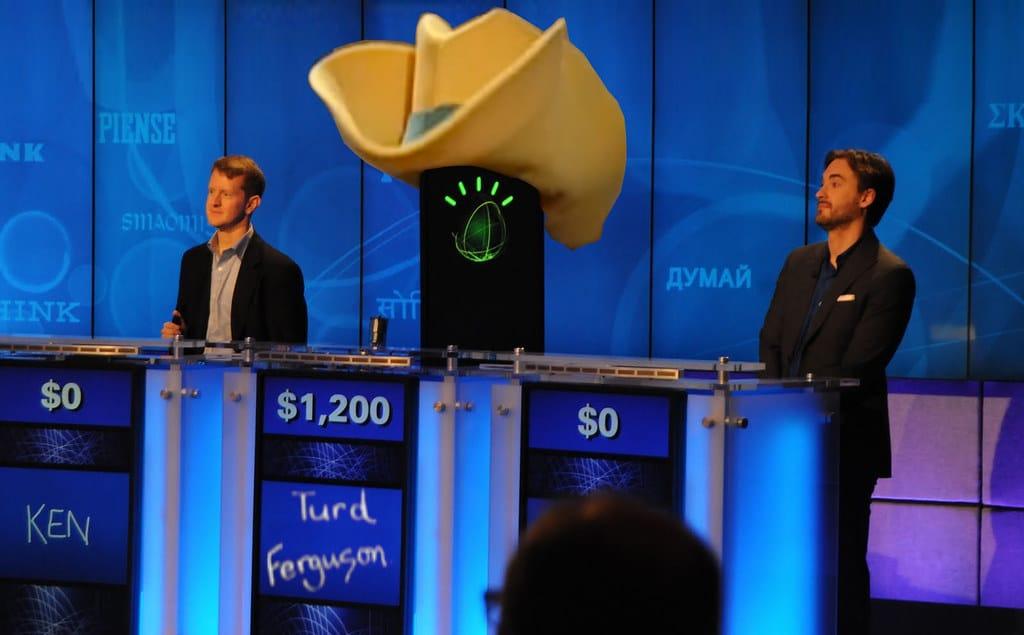 Funny image of Ken Jennings, Brad Rutter and A.I. Watson, dressed as SNL character Turd Ferguson