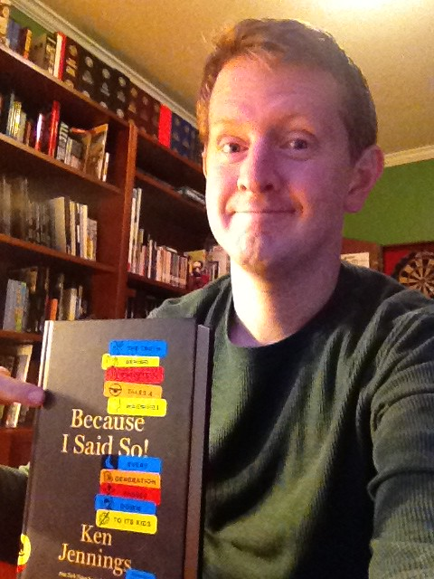 """Jeopardy! winner Ken Jennings holding up his book """"Because I Said So!"""""""