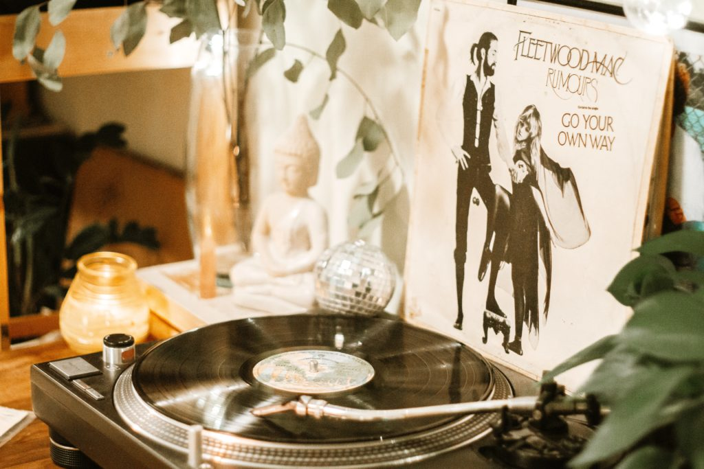 Fleetwood Mac's Rumours vinyl playing on a tabletop record player.