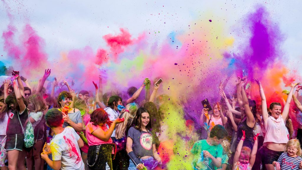 Kids playing in multicolor paint.