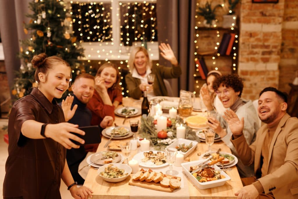 Group of people taking a selfie together at dinner
