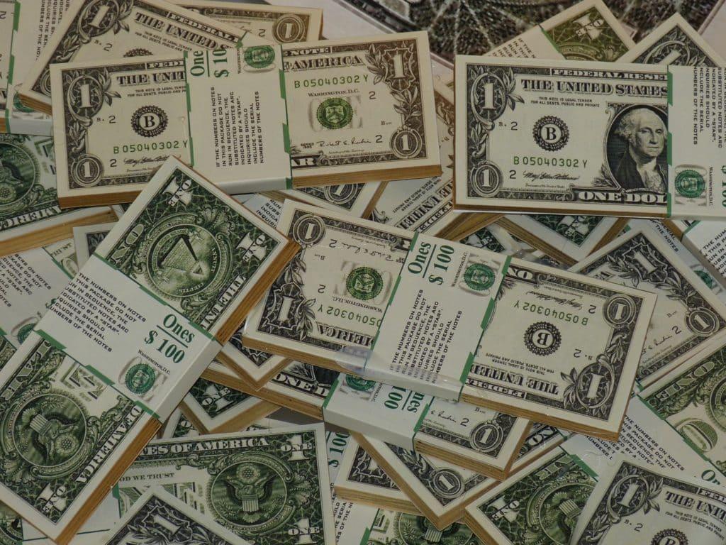 Stacks of one U.S. dollar bills