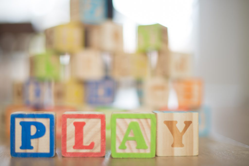 """Blocks spelling out the word """"PLAY"""""""