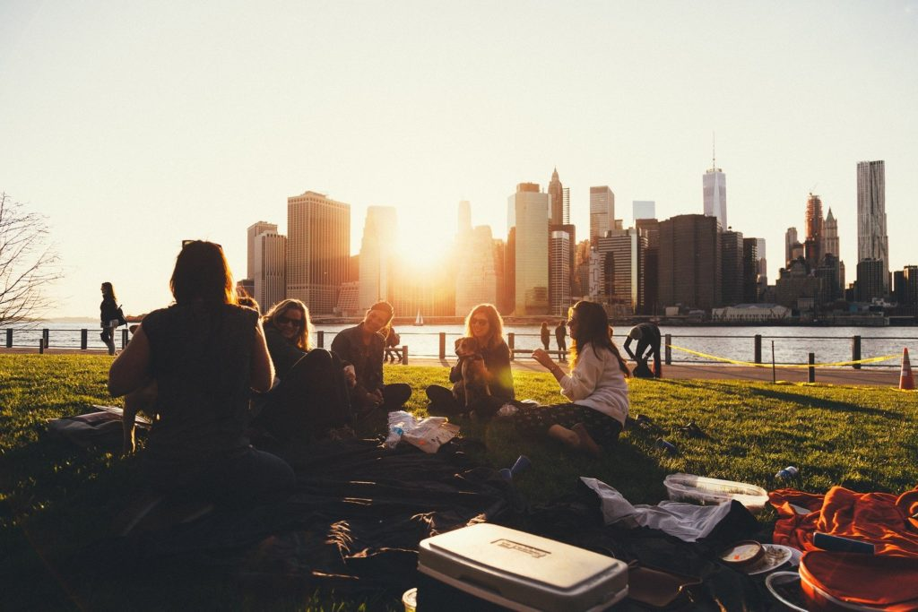 Group of people sitting outside in a city park