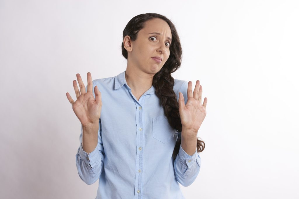 """Woman holding her hands up as if to say """"no"""""""
