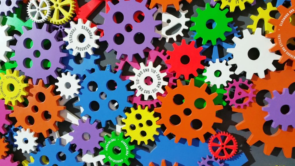 """A series of colorful gears similar to a """"settings"""" icon."""