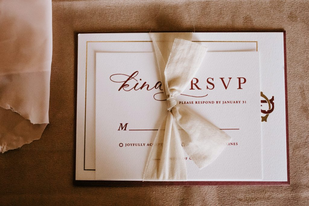 A fancy invitation with an RSVP date.