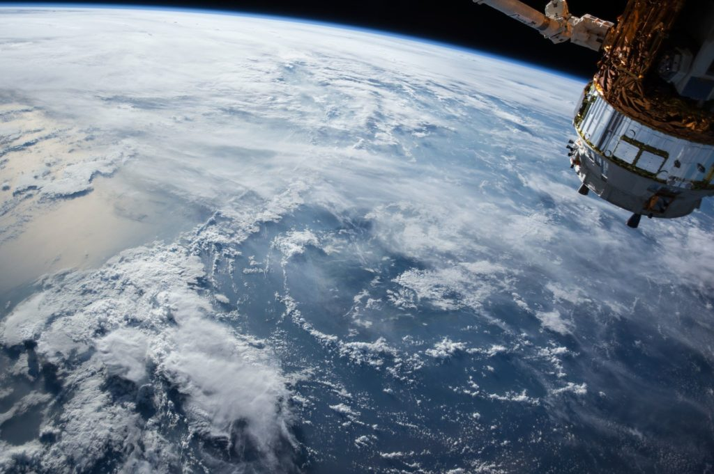 Satellite hovering over earth.