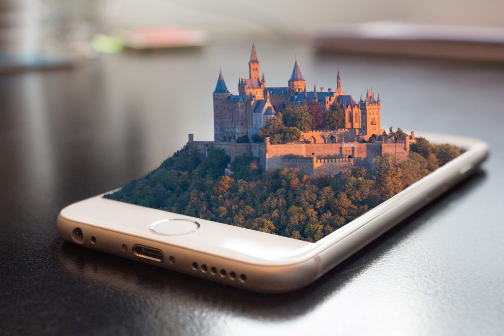 An image of a phone with a kingdom coming out of it.