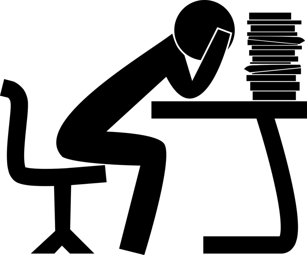 Illustration of a person at a desk with a pile of textbooks.